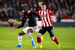 Marcus Rashford of Manchester United takes on John Fleck of Sheffield United - Mandatory by-line: Robbie Stephenson/JMP - 24/11/2019 - FOOTBALL - Bramall Lane - Sheffield, England - Sheffield United v Manchester United - Premier League
