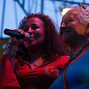 Chandra Pitts, Left, and Genny Pits, Right, Address the audience during The 19th Annual Bob Marley People's Festival Saturday, July 27, 2013, at Tubman-Garrett Riverfront Park in Wilmington Delaware.