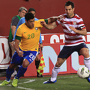 Hulk, Brazil, (left) is challenged by Carlos Bocanegra, USA, during the USA V Brazil International friendly soccer match at FedEx Field, Washington DC, USA. 30th May 2012. Photo Tim Clayton