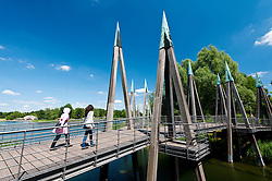 Abstract wooden footbridge crossing lake at Britzer Garden in Neukolln in Berlin Germany
