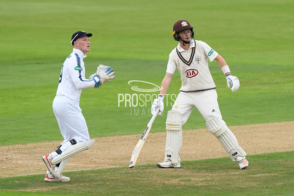 Wicketkeeper Tom Alsop of Hampshire and Batsman Ollie Pope of Surrey during the Specsavers County Champ Div 1 match between Hampshire County Cricket Club and Surrey County Cricket Club at the Ageas Bowl, Southampton, United Kingdom on 6 September 2017. Photo by Graham Hunt.