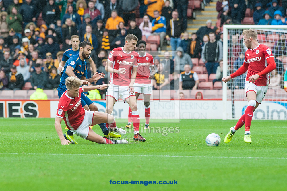 Fraizer Campbell of Hull City is tackled by Cameron McGeehan of Barnsley during the Sky Bet Championship match at Oakwell, Barnsley<br /> Picture by Matt Wilkinson/Focus Images Ltd 07814 960751<br /> 21/10/2017