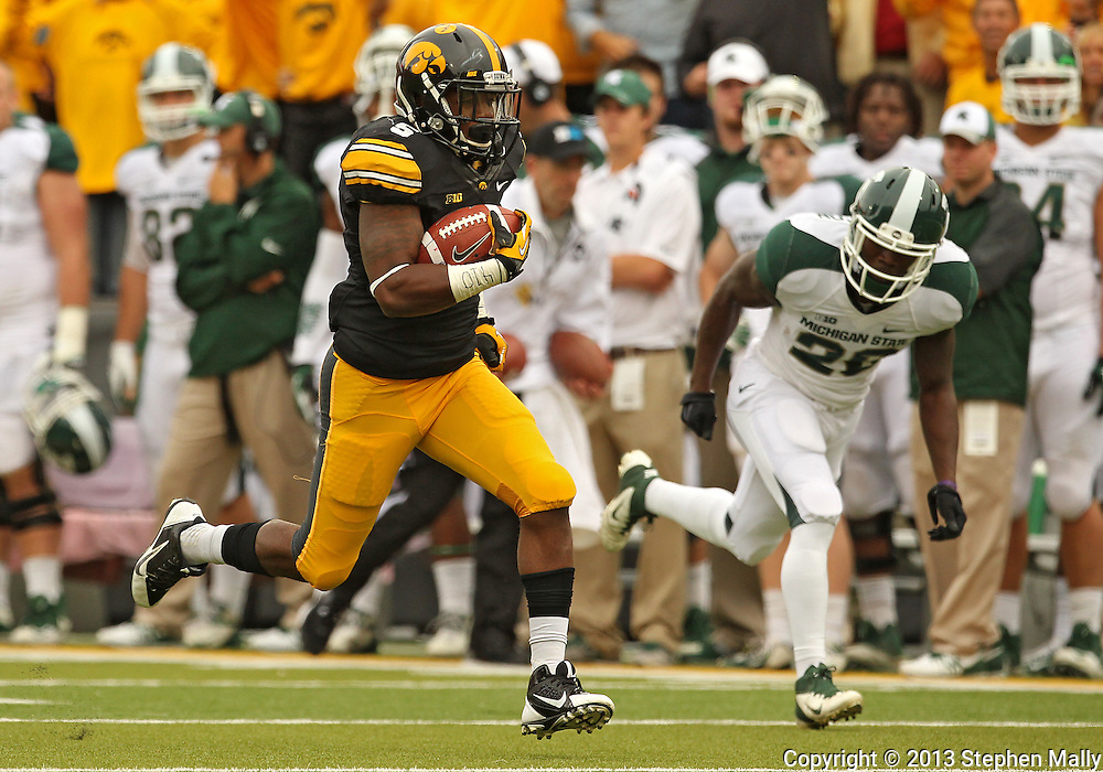 October 6 2013: Iowa Hawkeyes running back Damon Bullock (5) runs 47 yards for a touchdown after a reception during the second quarter of the NCAA football game between the Michigan State Spartans and the Iowa Hawkeyes at Kinnick Stadium in Iowa City, Iowa on October 6, 2013.