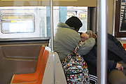 November 1, 2013-Couple sleeping on the A train. 11/1/2013 - Photo by Rosa Goldensohn/NYCity Photo Wire