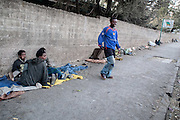 Homeless boys of Addis Ababa. Ethiopia 27-03-08...///   In Addis Ababa 85% of the population lives in slums, about 21% of people in the capital city are living on less than 1 dollar per day..Migration to urban areas is usually motivated by the hope of better living conditions. Society growth, migration, and urbanization are straining governments capacity to provide people basic services. Poverty and health conditions are getting worse. Over than 120.000 people live without house, 18% are kids, with ages between 7 and 20 years old. Severals NGOs supply the problem by various support programs. Italian organization provide by the help of young street artistes with circus therapy project.