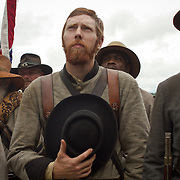 """Michael Jantzen, of Freeport, Michigan, holds his hat to his heart during a moment in front of the Robert E. Lee statue at the Virginia Memorial during the Sesquicentennial Anniversary of the Battle of Gettysburg, Pennsylvania on Wednesday, July 3, 2013.  Jantzen regarded Lee and Stonewall Jackson as heroes """"...not for their ability on the battlefield, but for the lives they led as good Christian men...""""  The Battle of Gettysburg lasted from July 1-3, 1863 resulting in over 50,000 soldiers killed, wounded or missing.  John Boal Photography"""
