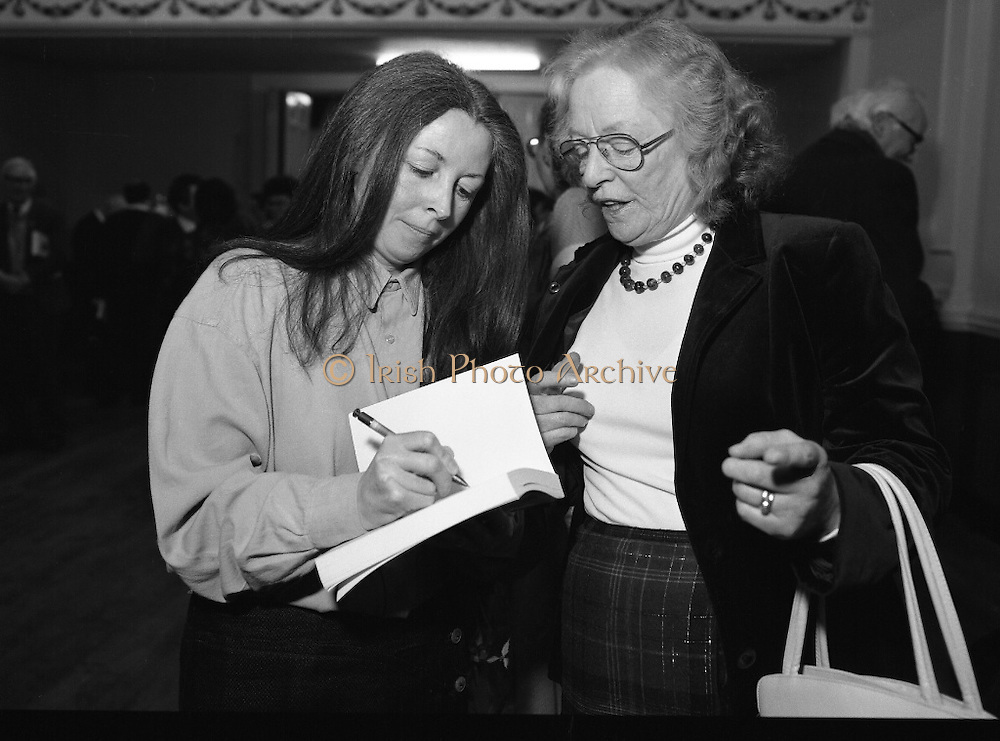 """These Obstreperous Lassies"" Book Launch.  (R93)..1988..15.12.1988..12.15.1988..15th December 1988..A book which chronicles an important aspect of Irish social history was launched in Larkin Hall. ""These Obstreperous Lassies"" written and researched by Mary Jones, details the seventy three years of the Irish Women Workers Union and of the women who were involved in the union..With Countess Markievicz as its first president, The Union began the fight for equal pay and fair treatment under the leadership of women like helen Chenevix, Louise Bennett and Helena Molloy. They fought for the rights of vulnerable workers such as Laundresses,print workers,box makers,nurses and dressmakers..The Author, Mary Jones, is a full time researcher specialising in Women and Work...Picture shows the Author Mary Jones signing a copy of her book at its launch in Larkin Hall, Parnell Square."