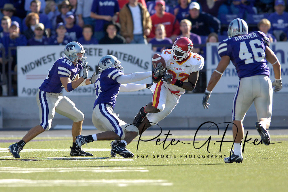 Iowa State wide receiver Milan Moses (32) takes the ball away from Kansas State defensive back Joshua Moore (13) in the first half at Bill Snyder Family Stadium in Manhattan, Kansas, October 28, 2006.  The Wildcats beat the Cyclones 31-10.<br />