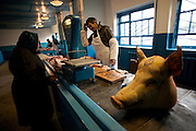 A butcher helps a customer select from his cuts of the day at a meat market in Hoiniki on Oct. 25, 2009.