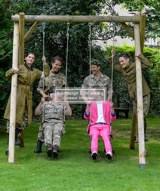 Pictured: Performer Nick Alban, from show the Happiness Prohect chats with Brigadier Suzanne Kindsay and pushed by Brigadier Robin Lindsay Commander 51 Brigade and Simone Ibbett Brown (Dead Equal) along with opera singer Lila Palmer and Teiya Kasahara from the show Dead Equal.<br /> <br /> The Army at the Fringe venue opened it's doors today, with five shows on. <br /> <br /> © Dave Johnston / EEm