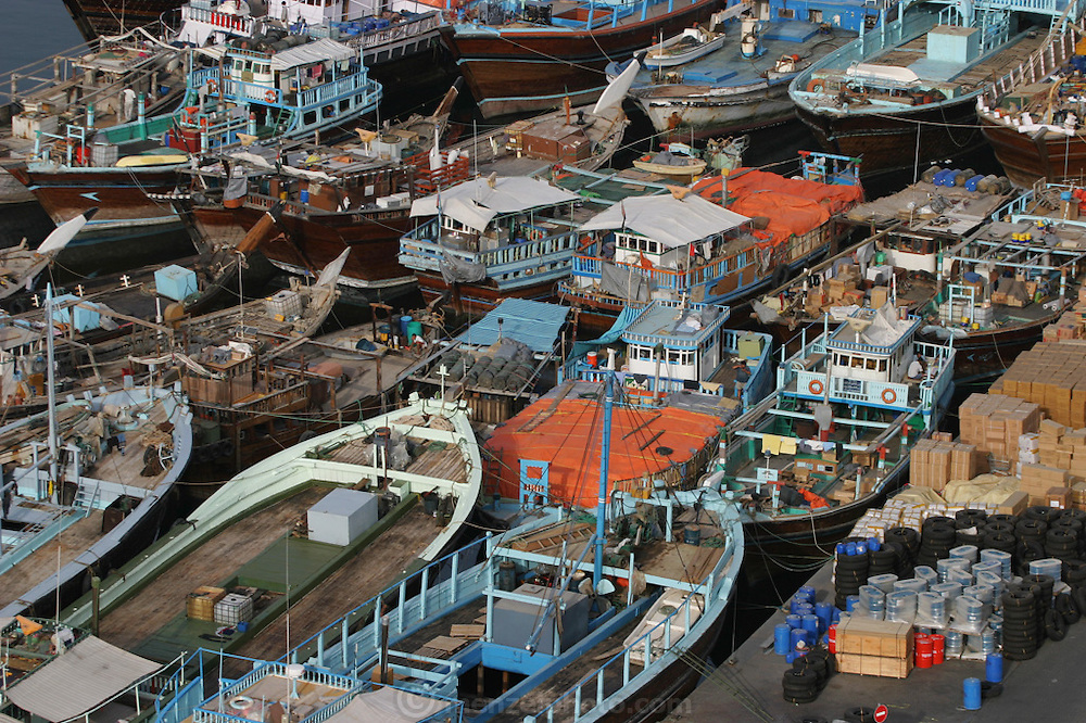 Boats and small ships docked in Dubai Creek, Dubai, United Arab Emirates.