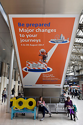 © Licensed to London News Pictures. 07/08/2017. London, UK. Liberal signage informs commuters of impending works.  Rail passengers face disruption at Waterloo station where nearly half the platforms have been closed until August 28 for a station upgrade.  Photo credit : Stephen Chung/LNP