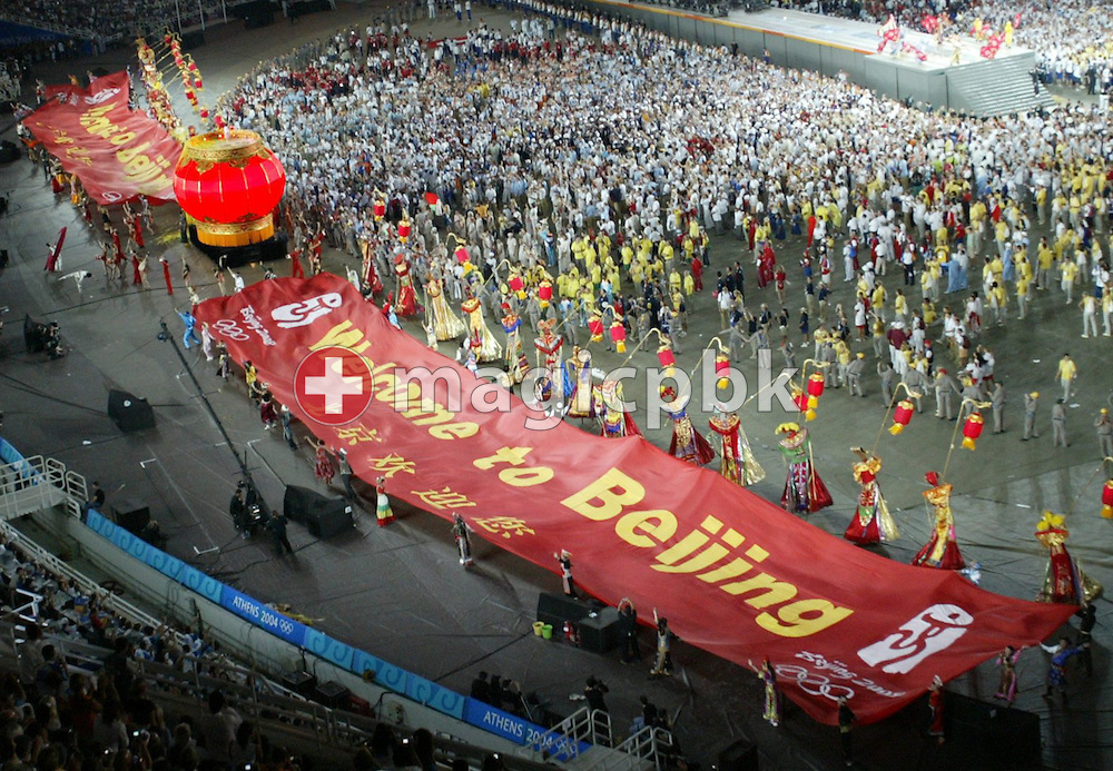 "A huge banner with the words ""Welcome to Beijing"" is dismantled during the Closing Ceremony of the Athens 2004 Olympic Games, in the Olympic Stadium, Sunday 29 August 2004.   (Photo by Patrick B. Kraemer / MAGICPBK)"