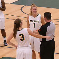 5th year forward Charlotte Kot (1) and 5th year guard Katie Polischuk (3) of the Regina Cougars have a few words with the ref prior to tip off. Credit: Arthur Ward/Arthur Images