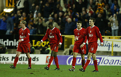 WOLVERHAMPTON, ENGLAND - Wednesday, January 21st, 2004: Liverpool's (l-r) Stephane Henchoz, Emile Heskey, Steven Gerrard and Dietmar Hamann look dejected after conceding an equaliser against Wolverhampton Wanderers during the Premiership match at Molineux. (Pic by David Rawcliffe/Propaganda)