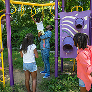 WASHINGTON, DC -JUL22: Erik Beard, 23, works at Beautiful U summer camp in Southeast, Washington, DC, through DC's Student Youth Employment Program, SYEP, July 22, 2015. (Photo by Evelyn Hockstein/For The Washington Post)
