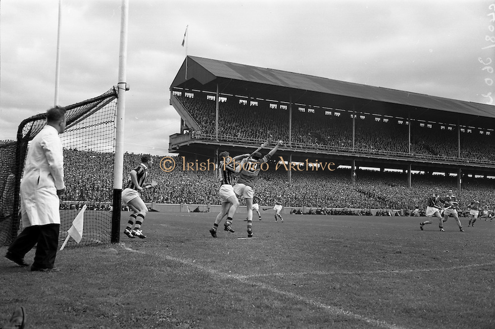 06/09/1964<br /> 09/06/1964<br /> 6 September 1964<br /> All-Ireland Senior Final: Tipperary v Kilkenny at Croke Park, Dublin.<br /> Exciting moments at the Kilkenny goal when S. McLoughlin (Tipperary forward) gets the ball in a tussle with Kilkenny defenders. Moments later, the ball went into the net and Tipperary's second goal went up on the scoreboard. However, to the dissapointment of the Tipperary supporters, the score was disallowed.