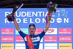 London, UK. 4 August, 2019. Elia Viviani of Deceuninck-Quick-Step stands on the podium after winning the Prudential RideLondon Classic, Britain's only men's UCI WorldTour race and the richest one-day race in the world with a prize pot of 100,000 Euros on offer. This year's race features a redesigned race route from a start in Bushy Park in south-west London through Surrey, including a five-lap circuit of Box Hill, to a finish on the Mall.