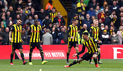 Watford's Etienne Capoue (second right) celebrates scoring his side's first goal of the game during the FA Cup quarter final match at Vicarage Road, Watford.