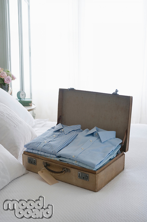 Pressed shirts in a suitcase