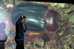 UC Davis entomology graduate student Ralph Washington, Jr., left, leads patrons on a brief journey through the wonders of insect life, at the once-monthly Nerd Nite event, Monday, April 24, 2017, at Club 21 in the Uptown neighborhood of Oakland, Calif. (Photo by D. Ross Cameron)