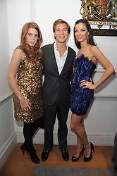 Left to right, PRINCESS BEATRICE OF YORK, DAVE CLARK and GEORGINA CHAPMAN at a party to launch the Georgina Chapman collection for Garrard held at Garrard, Albermarle Street, London on 4th November 2009.