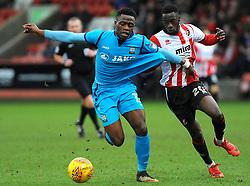 Mohamed Eisa of Cheltenham Town shirts pulls David Tutonda of Barnet - Mandatory by-line: Nizaam Jones/JMP- 27/01/2018 - FOOTBALL - LCI Rail Stadium- Cheltenham,England - Cheltenham Town v Barnet -Sky Bet League Two