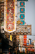 Old signs lining the roads of Chinatown in the early morning, Bangkok, Thailand, Southeast Asia