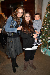 Left to right, CATHERINE BAILEY, her daughter PALOMA BAILEY and her son SAMIR at a VIP evening hosted by Joely Richardson at the Tiffany & Co Christmas Shop, Tiffany & Co Old Bond Street, London on 24th November 2013.
