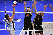 Pepperdine Waves outside hitter Michael Wexter (1) attempts to hit the ball past Princeton Tigers outside hitter Peter Dixon (22) and middle blocker Billy Andrew (1) during an NCAA Championships opening round match, Wednesday, April 30, 2019, in Long Beach, Calif. Pepperdine defeated Princeton 25-23, 19-25, 25-16, 22-25, 15-8.