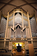 The Rev. Dr. Christopher Ahlman, LCMS missionary in Leipzig, Germany,  performs on the Town and Parish Church of St. Mary's organ during a choral concert after the dedication of The International Lutheran Center at the Old Latin School on Sunday, May 3, 2015, in Wittenberg, Germany. LCMS Communications/Erik M. Lunsford