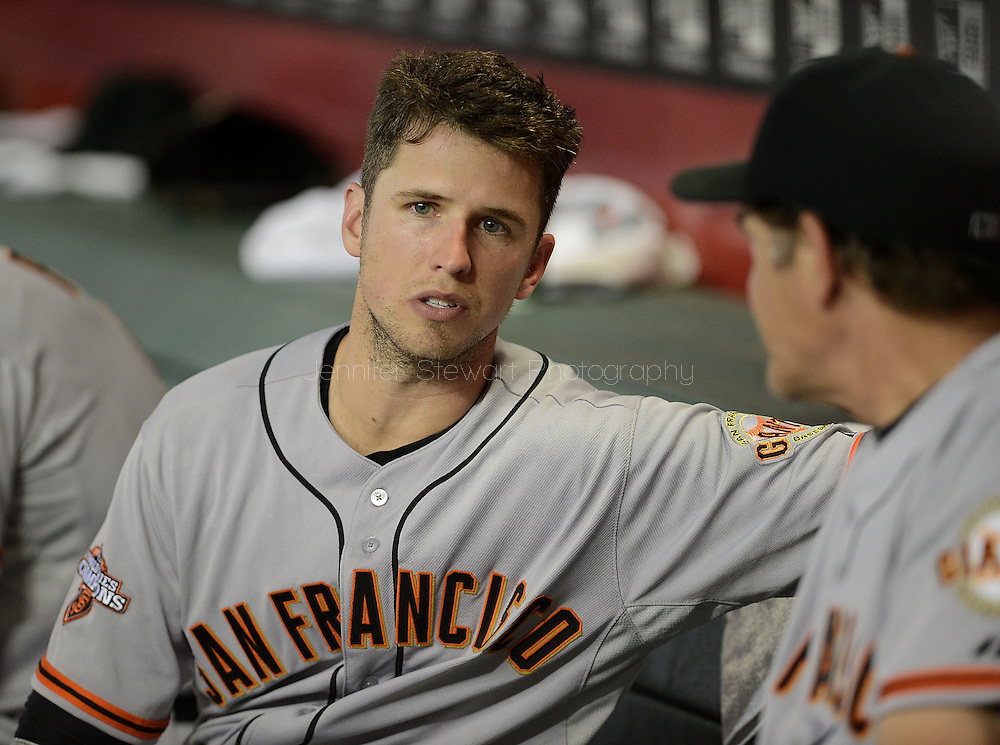 PHOENIX, AZ - JUNE 07:  Catcher Buster Posey #28 of the San Francisco Giants talks on the bench with pitching coach Dave Righetti #33 during the game against the Arizona Diamondbacks at Chase Field on June 7, 2013 in Phoenix, Arizona.  The Diamondbacks defeated the Giants 3-1.  (Photo by Jennifer Stewart/Getty Images) *** Local Caption *** Buster Posey; Dave Righetti
