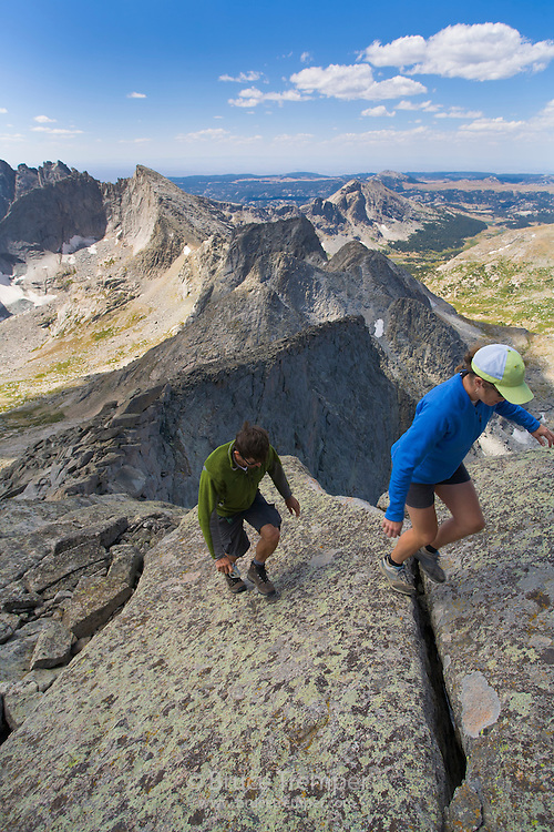 Jeremy Gay and Lisa Rew hike in the cirque of the Towers, Wind River Range, Wyoming.