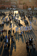 Morocco, Marrakesh. People enjoying sunset at Djemaa el Fna.