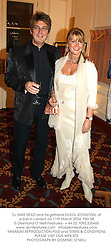 DJ MIKE READ and his girlfriend EILEEN JOHNSTON, at a ball in London on 11th March 2004.PSH 58
