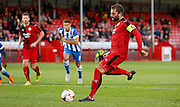 Simon Walton with the penalty for Crawley during the Pre-Season Friendly match between Crawley Town and Brighton and Hove Albion at the Checkatrade.com Stadium, Crawley, England on 22 July 2015. Photo by Michael Hulf.