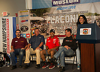 Tom Netishen Flat Track Racing, Greg Goddard Manager Gunstock Mountain Resort, Flat Track racer Cameron Smith and David McGrath Director NHMS join Cynthia Makris Naswa on stage to present the upcoming events during the 2019 kickoff to Laconia's 96th Motorcycle Week Thursday morning at the North East Motor Sports Museum in Loudon.  (Karen Bobotas/for the Laconia Daily Sun)