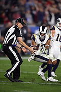 Los Angeles Rams wide receiver Robert Woods (17) flips the ball to an official after catching a late second quarter pass for a gain of 38 yards to the Falcons 7 yard line during the 2018 NFC Wild Card NFL playoff football game against the Atlanta Falcons, Saturday, Jan. 6, 2018 in Los Angeles. The Falcons won the game 26-13. (©Paul Anthony Spinelli)