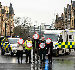 Pictured: Superintendent Fraser Candlish, from Police Scotland, and John Alexander from Scottish Ambulance Service, were joined on a crossing to high;light atat every nine minutes an accident happens.<br /> The &quot;In Town, Slow Down&quot;  road safety campaign was launched today in Edinburgh to encourage drivers to watch their speed in built-up areas, amid figures showing someone is stopped for speeding in Scotland every nine minutes. Superintendent Fraser Candlish from Police Scotland, and John Alexander from Scottish Ambulance Service were on hand to help with the launch<br /> Ger Harley | EEm 7 February 2017
