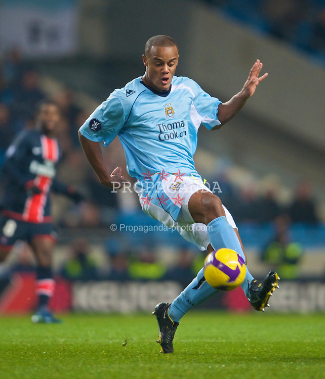 MANCHESTER, ENGLAND - Wednesday, December 3, 2008: Manchester City's Vincent Kompany in action against Paris Saint-Germain during the UEFA Cup Round of 32 Group A match at the City of Manchester Stadium. (Photo by David Rawcliffe/Propaganda)