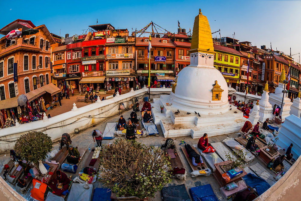 Tibetan Buddhists prostrating themselves at the Boudhanath Temple, Kathmandu, Nepal.  It is the largest stupa in Nepal and the holiest Tibetan Buddhist temple outside Tibet. It is the center of Tibetan culture in Kathmandu.