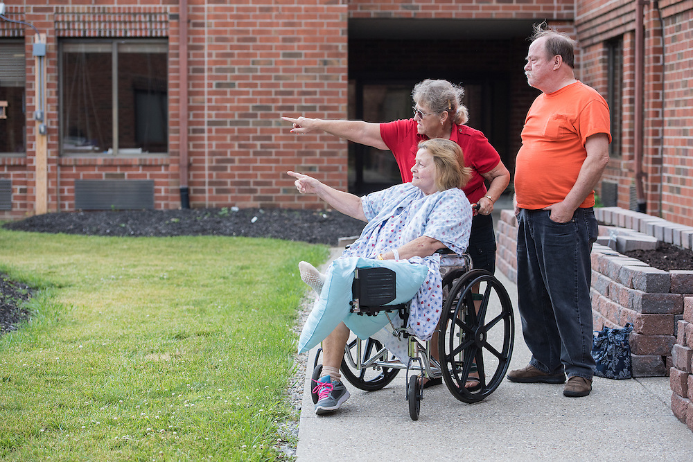 Patient Dora Gribbons outside in the Genesis Garden space with her brother Sherman Thornbury and his wife Susan Thornbury, Wednesday, May 27, 2015 at Baptist Health in LaGrange, Ky. (Photo by Brian Bohannon/Videobred for Baptist Health)
