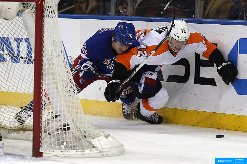 Derek Dorsett, (left), Rangers, and Michael Raffl, Flyers, challenge for the puck during the New York Rangers Vs Philadelphia Flyers, NHL regular season game at Madison Square Garden, New York, USA. 26th March 2014. Photo Tim Clayton