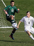 Middletown, New York - High school soccer players battle for the ball during the New York State Class D boys' soccer championship game on Nov. 20, 2011.