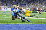 DETROIT, MI - JANUARY 01: Lions wide receiver Anquan Boldin (80) gets tackled by Packers strong safety Micah Hyde (33) just shy of the goal line during a NFC North NFL football game between Detroit and Green Bay on January 1, 2017, at Ford Field in Detroit, MI. (Photo by Adam Ruff/Icon Sportswire)