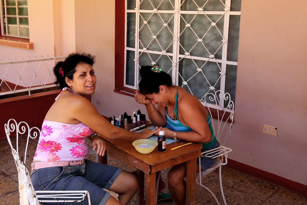 Nail decorating service on a house porch in Alquizar, Artemisa, Cuba.