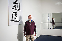 CASABLANCA, MOROCCO - 14 MAY 2016: Luqman Abdul-Hakeem (82), a close follower of Malcolm X that chauffeured the African American activist around and introduced him to Cuban leader  Fidel Castro in September 1960, poses for a portrait in one of his two dojos where he has taught aikido up until his surgery two years ago, in Sidi Maarouf, a district of Casablanca, Morocco, on May 14th 2016.<br /> <br /> Born in Cleveland, OH, in 1934, Luqman Abdul-Hakeem was raised in Flushing, Queens, and then moved to Bayside, where he graduated in 1952. He attended the New York Technical University for a few months before enrolling in the Navy, where he stayed for two years. Though he had asked for ship duty, he ended up in Springfield, Mass., and Glennclose, Ill. He moved to Brooklyn when his hitch was done and by 1966 was studying jujitsu and aikido. He met Malcolm X during one of his sermons on 116th street in Harlem, New York, in the late 50's. In 1985, Mr. Hakeem decided to move to Marocco because America wasn't a country where he wanted to raise hois children. He has been teaching aikido in the two dojos he owns in Casablanca until 2014, when he underwent a surgery.