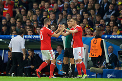 LILLE, FRANCE - Friday, July 1, 2016: Wales' Joe Ledley is substituted for Andy King against Belgium during the UEFA Euro 2016 Championship Quarter-Final match at the Stade Pierre Mauroy. (Pic by David Rawcliffe/Propaganda)