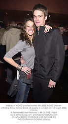 MISS LEAH WOOD and her brother MR JESSE WOOD children of Rolling Stone Ronnie Wood, at a party in London on 21st March 2002.OYO 34