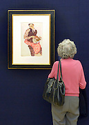 © Licensed to London News Pictures. 31/01/2013. London, UK A woman stands in front of  Egon Schiele's .LIEBESPAAR (SELBSTDARSTELLUNG MIT WALLY) (LOVERS - SELF-PORTRAIT WITH WALLY) Estimated to raise 6,500,000 - 8,500,000 GBP. Preview of highlights from Sotheby's forthcoming February sales of Impressionist & Modern Art and Contemporary Art in London, including works by Picasso, Bacon, Monet, Richter and Miró. Photo credit : Stephen Simpson/LNP